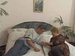 Granny And Boy On A Bed